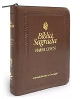Bíblia sagrada com harpa cristã e fecho